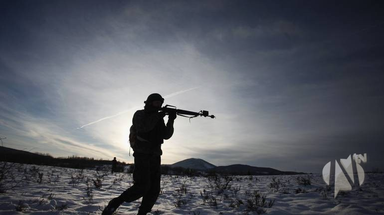 A soldier of the Armed Forces of Bosnia and Herzegovina (OSBIH) takes position during an exercise on the Manjaca mountain, near Banja Luka, December 14, 2012. The exercise, which tests soldiers on conquering a territory and rescuing the wounded from a war zone, is the final one for the basic officer trainee course. Picture taken on December 14, 2012. REUTERS/Dado Ruvic (BOSNIA AND HERZEGOVINA - Tags: TPX IMAGES OF THE DAY MILITARY)